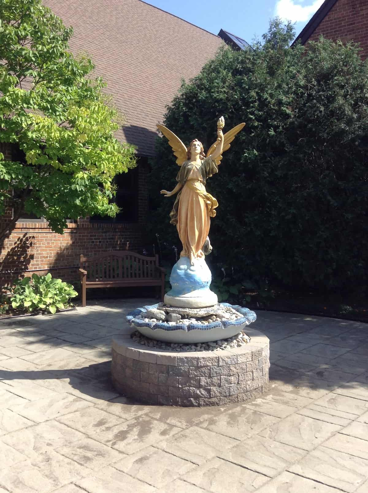Church entrance angel statue